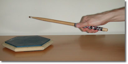 Pushing the stick down with your fingers.